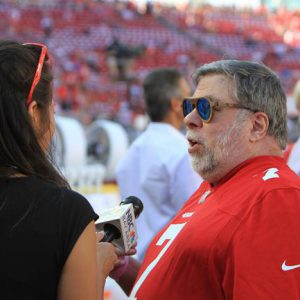 A reporter spots Woz at the game.